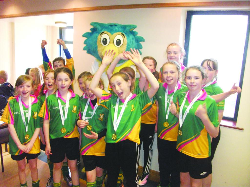 Ulster Finals 2016 -Clontibret GAA team celebrate with Oltan 1